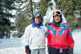 """Hugh Evans, left, and Jim Nassar, both veterans from the U.S. Army's 10th Mountain Division, stand in front of """"The Ski Trooper,"""" a statue dedicated to the men who served in the 10th Mountain Division during World War II, in Vail on Tuesday. The veterans were in Vail for the division's annual ski day."""
