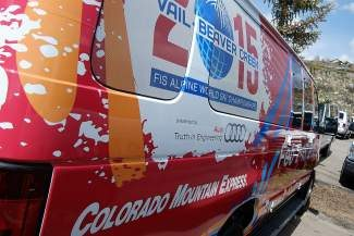 Colorado Mountain Express has decorated some of its vehicles with the 2015 FIS World Championships insignia. Many local businesses are sponsoring next year's event.