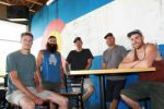The crew at 7 Hermits Brewing Co. takes a break from the frenzied construction activity at the new location at Capitol and Founders in Eagle Ranch Village. The brewpub is slated to re-open next week.