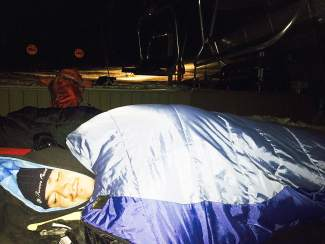 Vail's Cesar Hermosillo camps out under the chairlift at Arapahoe Basin at around 3 a.m. on the morning of opening day for the 2014-15 ski season.
