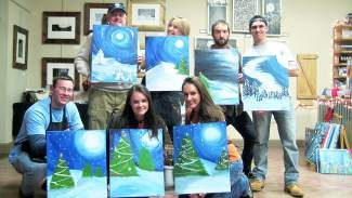 A special Cocktails & Canvas class is being held at Alpine Arts Center on Christmas Eve; these are some of the finished masterpieces from last year's step by step painting and wine event.