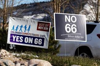 Signs for and against the proposed Amendment 66 sit at a roundabout just in front of the Battle Mountain High School in Edwards. The tax did not pass in the state.