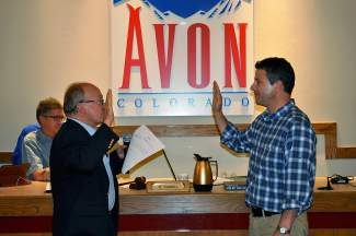 Judge Buck Allen, left, swears in Matt Gennett to the Avon Town Council on Tuesday. Gennett will replace councilman Todd Goulding, who moved to Edwards.