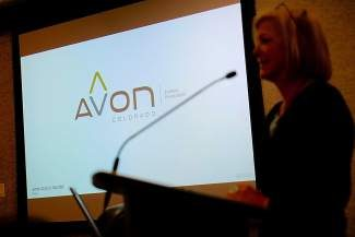 Susan Fairweather, Director of Economic Initiatives for the town of Avon, presents the new Town of Avon logo to the Avon town council on Tuesday. The logo, part of a $43,500 branding effort, received mixed reviews from council members.