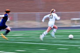 Trailed by Mullen defender Laura Stateler, Battle Mountain's Morgan Croke dashes to the goal and scores the first goal of the game in Edwards on Friday. Battle Mountain went on to win, 2-0.