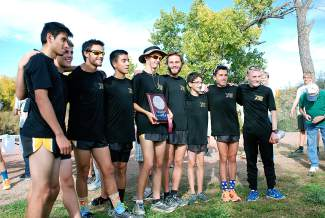 The Battle Mountain boys cross-country team strikes a pose after qualifying for state and winning the league title on Friday in Delta.