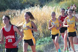 From left, Battle Mountain's Anabel Johnson, Kaela Fahrney and Megan Rossman take it out as a pack during the regional meet at Delta on Friday. The Huskies girls cross-country team made it a four-peat when it comes to regional and league titles.