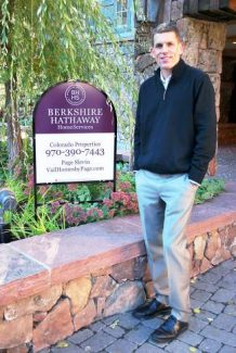 Berkshire Hathaway Home Services Colorado Properties managing broker Michael Slevin with one of the company's new signs. The company this week completed the process of changing its name from Prudential Colorado Properties.