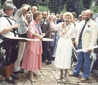Mrs. Betty Ford cuts the ribbon for the Betty Ford Alpine Gardens in August of 1989. Marty Jones is to the right and  Helmut Fricker is on the left.