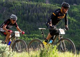 Jay Henry, right, fights to stay ahead of Cristhian Ravelo in the final stretch of the Camp Hale Hup mountain bike race Wednesday in Camp Hale. Ravelo overtook Henry with the finish line in sight to take first place in the men's pro division.