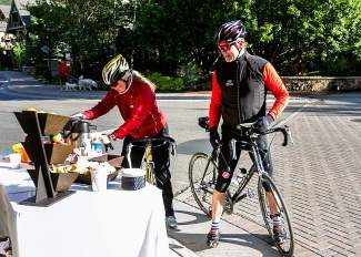 Connie Gardner, left, and her husband, Led, stop for a coffee break and to register for prizes during Colorado Bike to Work day Wednesday at Mayor's Park in Vail.