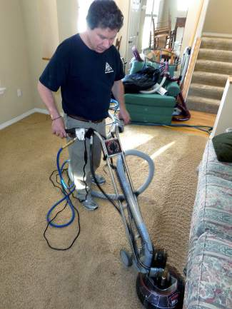 Jorge Umana operates his carpet cleaner in an Eagle home. His company, J&J Cleaning Services is one of the newest members of the Gypsum Chamber.