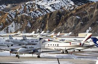 The Eagle County airport is packed with private planes and jets of tourists visiting the winter mountains for the holidays as seen here Tuesday in Gypsum.