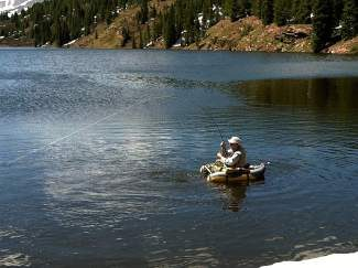 "Joe Mercer, of Denver, hooks one of the rainbow trout that was stocked in Black Lake No. 1 on Friday. Mercer said has been fishing the Black Lakes atop Vail Pass for ""years."""