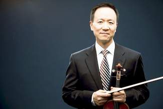 "Violinist David Kim and musicians of The Philadelphia Orchestra perform Vivaldi's ""The Four Seasons"" on July 8."