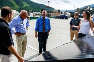 State senators Pat Steadman, center, and Rollie Heath, center left, talk with employees of Active Energies who highlight recent solar energy upgrades the town of Vail has been using in the sunny summer months at the Lionshead parking structure. The senators were on a tour visiting small businesses in Eagle and Garfield counties that have been active in their use of renewable energy.