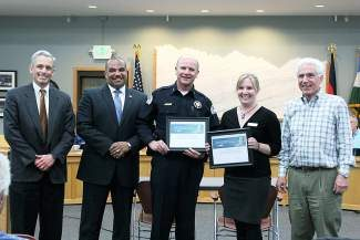 Vail Police Department Chief Dwight Henninger, middle, and Catholic Charities Regional Coordinator Megan McGee Bonta, second from right, were named recipients of the 2013 L. Anthony Sutin Civic Imagination Award. Presenting the award at Tuesday's Vail Town Council meeting were John Walsh, U.S. Attorney, District of Colorado; Ronald Davis, director of the Department of Justice Office of Community Oriented Policing; and Vail Mayor Andy Daly.