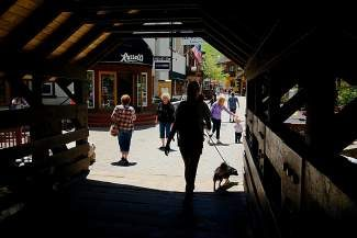 Pedestrians walk along Bridge Street near the covered bridge in Vail on Thursday. Bridge Street has recently seen some shifting around of businesses in the Village, as well as some businesses that have been there for years and had to leave altogether.