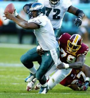 Washington Redskins' Bruce Smith sacks Philadelphia Eagles' Donovan McNabb in 2003. Smith will be a special guest to honor Dr. Richard Steadman at the Rock the Research event Monday in Vail.