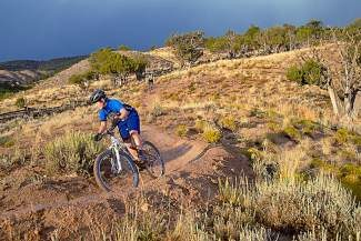 Sam Brown, an Eagle high school mountain bike competitor rides the new trail at the Haymeadow property. A grand opening and official naming ceremony for the trail is planned Friday, Sept. 13.