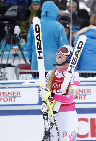 Lindsey Vonn of United States, reacts in the finish area following her run in the women's World Cup downhill ski race in Lake Louise, Alberta, Saturday, Dec. 6, 2014. (AP Photo/The Canadian Press, Jeff McIntosh)
