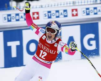 Lindsey Vonn of United States, celebrates in the finish area following her run in the women's World Cup downhill ski race in Lake Louise, Alberta, Saturday, Dec. 6, 2014. (AP Photo/The Canadian Press, Jeff McIntosh)