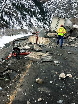 More than a dozen car-sized boulders fell Monday at the same location as a smaller slide that closed I-70 in both directions earlier in the day.