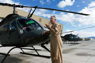 Helicopter pilot Carl Gray speaks about the two U.S. Army OH-58 helicopters that are going out on their last mission before being retired by the HAATS training facility in Gypsum. Gray has been flying in the area for more than 22 years and will be leaving with the helicopters.
