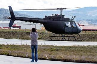 Joetta Gray takes a video while her husband Carl Gray takes his final lift-off before the helicopter and the pilot retire from the HAATS training center Wednesday in Gypsum.