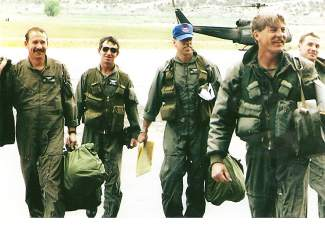 Carl Gray, second from left, with helicopter pilots and crew during his two tours in Vietnam. Gray started flying choppers for the Army in 1967. He retired this week from HAATS.