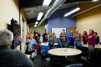 Democrats begin their caucus by reciting the Pledge of Allegiance in Edwards on Tuesday. Both Republicans and Democrats held caucuses throughout Colorado on Tuesday to begin choosing their political candidates for the 2014 midterm election.