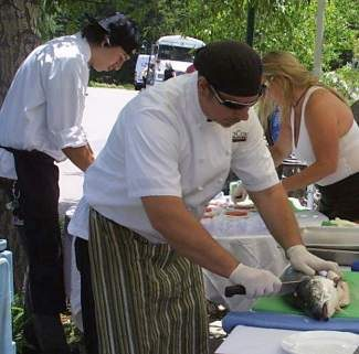 Chef's in the Gardens cooking demonstration entertain guests during a noon demo.