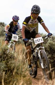 Cheyenne Mendoza, right, and Andrew Rogers, left, make the final push to the finish line during the Eagle Ranch Classic mountain bike race Wednesday in Eagle.