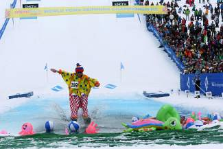 Local 14 year old, Thatcher May, scoots across the pool during the 2015 Spring Back to Vail Pond Skimming Championships in Vail on Sunday.