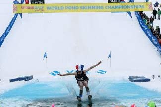 Alex McCaffrey, of Vail Ski Patrol, puts down his landing gear during the Spring Back to Vail World Pond Skimming Championships in Vail on Sunday. McCaffrey came out on top for the Men's division and went home with a new pair of Liberty skis.