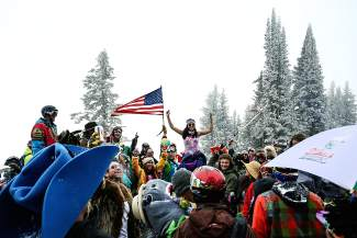 A party celebrating the end of the 2015 Vail mountain season is seen in full swing at the top of chair 4 Sunday on Vail Mountain. Cooler weather didn't thwart party goers from dawning costumes of all shapes and sizes.