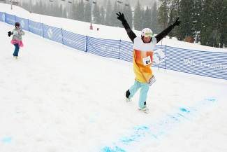 "Allison O'Brien, of Boulder, crosses the finish line in first place at Vail's Great Race 2.0 event Sunday. O'Brien and teammate Katie Post's team, ""The Beer Wenches,"" won top honors in the inaugural event."