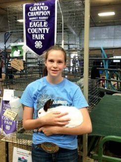 4-H Club member Autumn Russ and her grand champion rabbit at the recent Eagle County Fair Junior Livestock Auction.