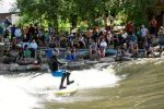 SALIDA, CO - JUNE 13, 2014: Badfish SUP team paddler  Mike Tavares puts on a paddle-surfing show at the Office Wave at the Salida Whitewater Park during last year's Arkansas River runoff.