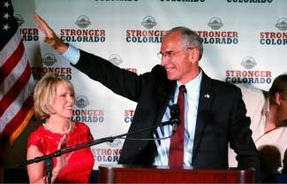 Republican gubernatorial candidate Bob Beauprez waves to supporters after winning the GOP primary at an election party in Denver on Tuesday. His wife Claudia is at left.