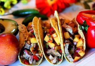 A fruit salsa is a great way to get more fruit into your diet and enjoy the bounty of summer. The salsa on these pork tacos is rich with peaches and cilantro.