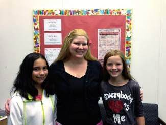 Eagle Valley Elementary School Principal Tiffany Dougherty, joined by a pair of EVES students.
