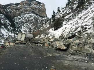 Daylight on Feb. 16 revealed semis stuck in Glenwood Canyon, and one severely damaged, after a massive rockfall on Interstate 70 about 8 miles east of Glenwood Springs at mile marker 124.