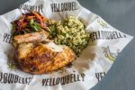 A roasted white whole chicken breast and wing is served with organic citrus quinoa and crunchy red slaw at Yellow Belly in West Vail. Yellow Belly specializes in all natural fried and rotisserie chicken, but also has many healthy sides and salads to choose from.