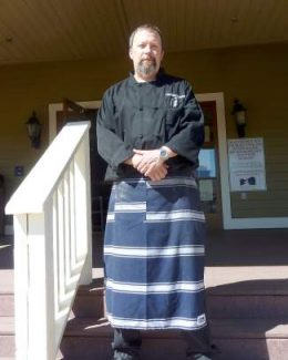 Executive Chef Ken Hansen stands at the entrance to The Creek Side Bar & Grill last April when the restaurant opened at the Gypsum Creek Golf Course.