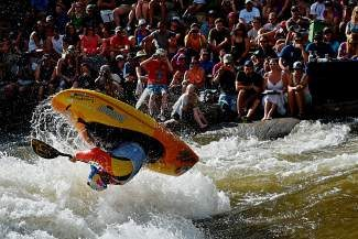 Dane Jackson competes in front of a crowd during the GoPro Mountain Games' kayak freestyle finals in Vail on Saturday. According to early counts, the games drew up to 58,000 spectators, up from 53,579 in 2013