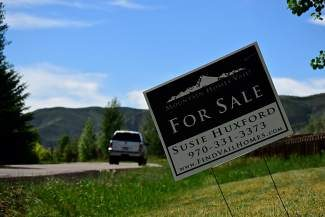 A for-sale sign is displayed in an Eagle-Vail yard on Monday. The month of April has reported the highest dollar volume for real estate sales in Eagle County since 2008.