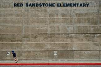 A boy plays outside of Red Sandstone Elementary School in Vail on Tuesday. After surviving a round of budget cuts a few years ago, district officials say Red Sandstone Elementary School's future is secure for the foreseeable future.