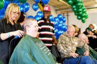 During the St. Baldrick's Foundation's annual fundraiser for childhood cancer research, Wendy Davis, of Eagle, has her head shaved by Claire Fox, of Gypsum at the Greater Eagle Fire Protection District's Shelton Station #9 in Eagle on Saturday. Davis shaved her head in support of her father who is suffering from non-Hodgkin lymphoma and is losing his hair due to chemotherapy treatment.