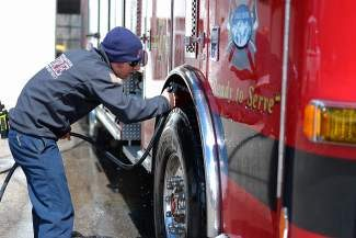 Firefighter Brian Nagle washes a new firetruck at Station 7 in Avon on Monday. In addition to the standard pumps and water equipment of a regular firetruck, this new truck is outfitted with technical rescue equipment as well. AEDs are also standard aboard all firetrucks.